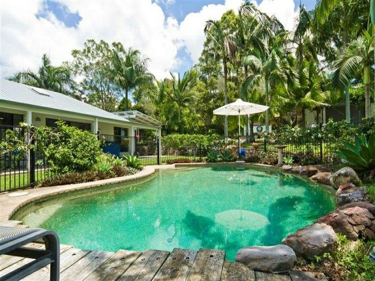 Residential Landscape Design Fees : Freeform pool design using wrought iron with decking outdoor furniture