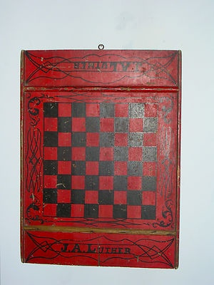19th century Salem,NY decorated and signed game board. 19 in long x 14 in wide. Interesting, i was always taught that for checkers, chess, etc. that the lowest right hand corner block was to be in white/or the lightest color painted on the board. Both ends of this board are painted black.