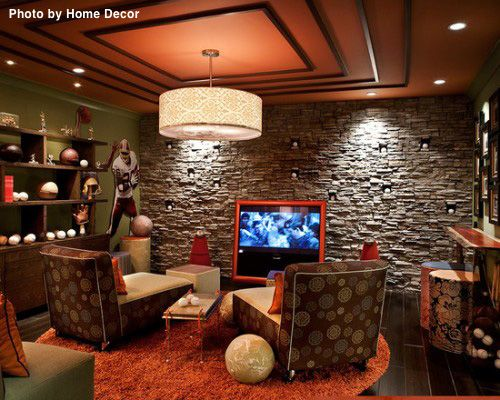This man cave has it all with the sports memorabilia on the side wall, a brick accent wall behind the TV and plenty of seating. #rustic #mancave