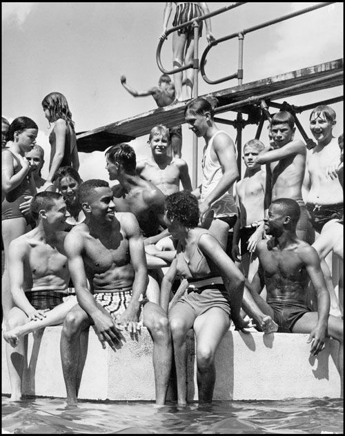 The photo above was taken on July 28, 1963, the second day black people were allowed in the pool. Front row, from left: F.J. Pepper of the Omaha Urban League,  Herb Rhodes,  Betty Jo Moreland and Dale Anders.  There was no trouble and the youths felt no outward hostility towards them, but the attendance was down that day and there were some grumblings of discontent  among the whites.