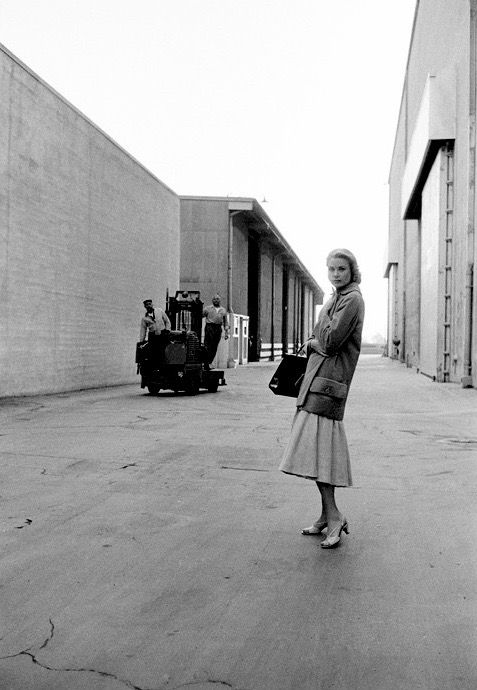 "Grace Kelly on the Hollywood studio lot. She is holding the famous Hermes handbag, which was called ""the Kelly bag"" after her love of it.                     Photo by Dennis Stock, 1956"