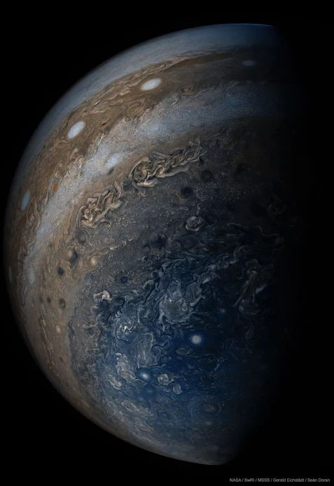 Beneath Jupiter | NASA Juno Mission | Jupiter is stranger than we knew. NASA's Juno spacecraft has now completed its sixth swoop past Jupiter as it moves around its highly elliptical orbit. Pictured, Jupiter is seen from below where, surprisingly, the horizontal bands that cover most of the planet disappear into swirls and complex patterns. A line of white oval clouds is visible nearer to the equator.