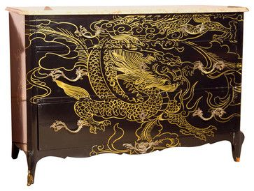 This chinoiserie ebonized commode decorated with a gilt dragon is a very unique piece. — Beth Connolly