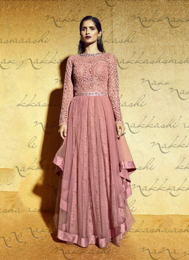 Featuring peach embroidered designer gown style suit intricately crafted with resham and mirror work. It is paired with matching bottom material and net duppata.This outfit can be stitched upto size 44. For stitching enquiries, please email us at customercare@hunardesigns.com  |…