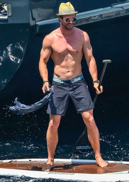 Is this a still of  <strong>Chris Hemsworth</strong> in  <em>Magic Mike 3XL: Return to Waterworld</em>?    GSI Media    <strong> WATCH: Aww! Chris & Elsa's daughter met Prince Harry and it was adorable</strong> Nah, it's just our very own God of Thunder on a paddle board in France! Look how jovial he is to be there! Hemsworth was vacationing off the Island of Corsica over the Fourth of July weekend and appears to have been shirtless basically the whole time.    GSI Media   Not that we're…