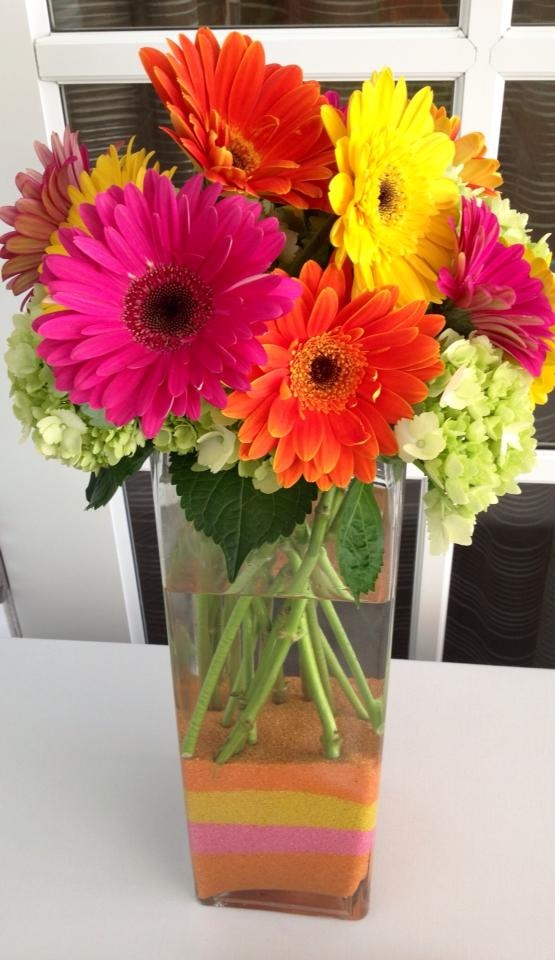 Gerberas. Lots of colors.  Hot pink, red, yellow, pink,  white, orange.