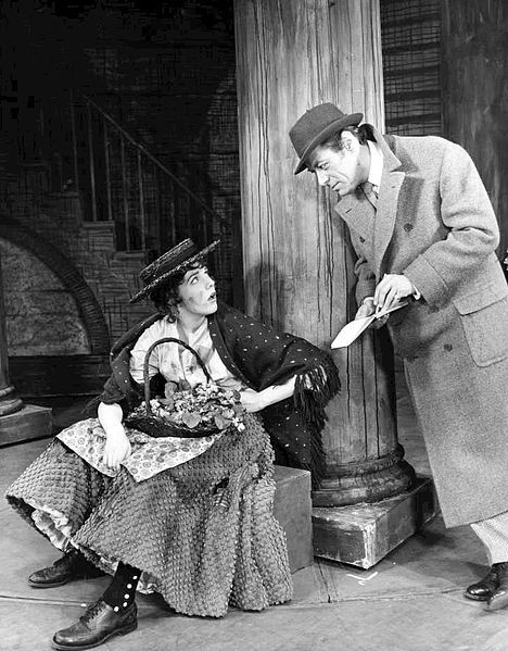 Julie Andrews and Rex Harrison from My Fair Lady. Eliza Doolittle, the flower girl, meets Professor Henry Higgins, 1957, public domain via Wikimedia Commons.