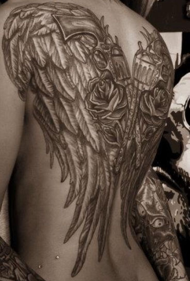 Angel Wings Tattoo. A little insane but very creative....x