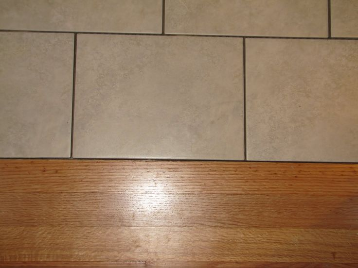 Another flush tile to wood transition new home ideas for Wood tile transition