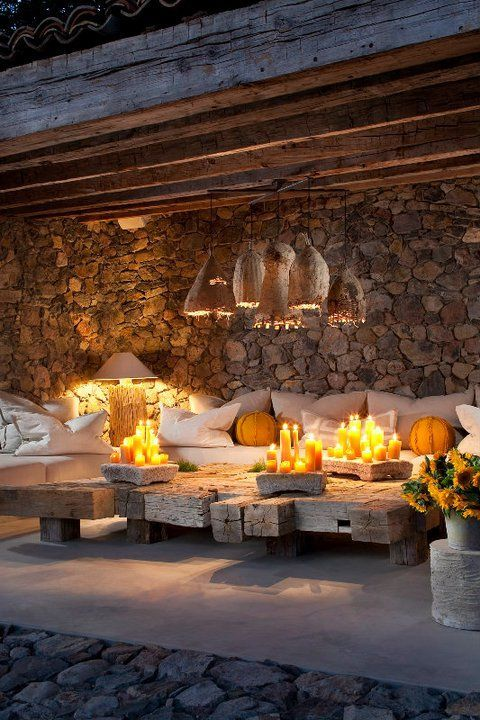 One of the beautiful outdoor lounging areas in Sonoma~ Love the splash of yellow and the coffee table constructed of old beams.: