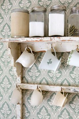 Vintage shelf with hanging mugs and kitchen staples