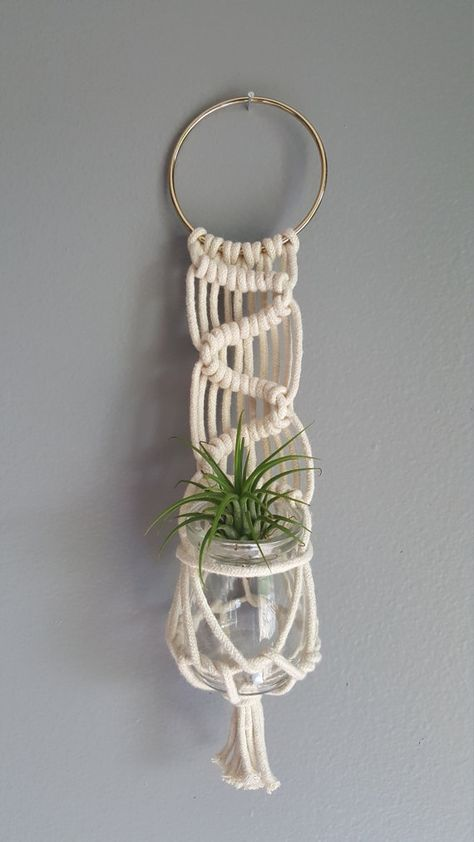 www.ketmercantile.com Macrame wall hanger, holds a small plant or fresh cut flowers. Air plant not included. Measures approx. 12 inches long with brass ring hanger.