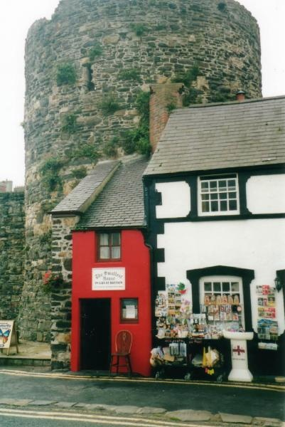 The smallest house in Great Britain. Conwy, Wales. That's part of Conwy Castle in the background