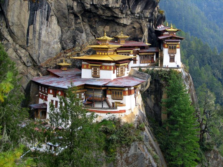 Tiger's Nest Monastery is on the edge of a cliff 3,000 feet above the Paro valley. It is 17th century temple. It is 2,950m (9,678 ft) above sea level. Read more : http://www.inditrip.in/2014/12/tigers-nest-monastery-paro-valley-bhutan.html
