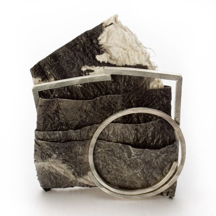 """Myung Urso - """"Sense"""" (2008). Brooch. Mulberry paper, oriental ink, thread, lacquer, sterling silver."""