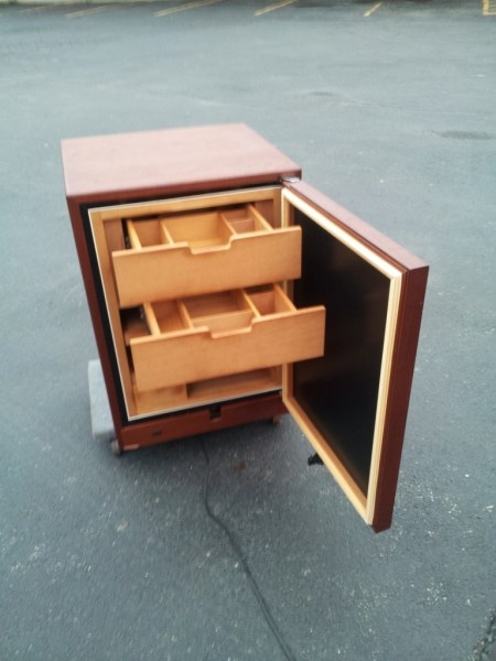 Climate controlled electronic humidor, which holds around 600 cigars. Shelves and drawers made of solid Spanish cedar. This is great professional humidor  for a true cigar enthusiast! $600