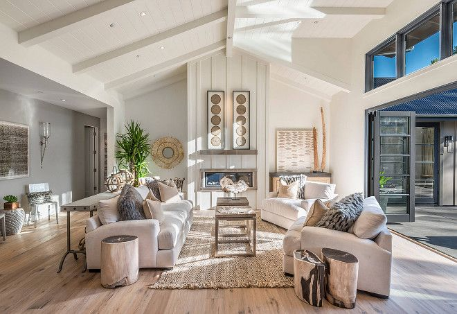 Living room vaulted ceiling with shiplap and folding patio doors. Open concept…