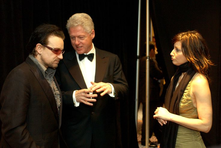 Bono, former President Bill Clinton and Gina Gershon at the MusiCares Person of the Year event in 2003. Description from zap2it.com. I searched for this on bing.com/images