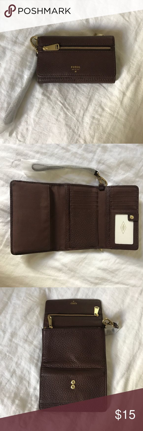 "NWT Fossil Brown Leather Smartphone Wristlet NWT Fossil Brown Leather Wristlet/Wallet 6""x4"" Wristlet strap length is 5.5"" Never used!! Cell phone pocket that fits an iPhone 6, 6S, and 7. 10 card slots! Perfect for every day use!! Fossil Bags Clutches & Wristlets"