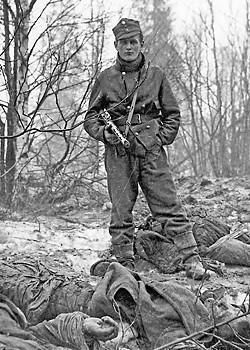 Swedish volunteer (Finnish army) Sgt Karl Arthur Axén with dead members of a Russian Patrol.: