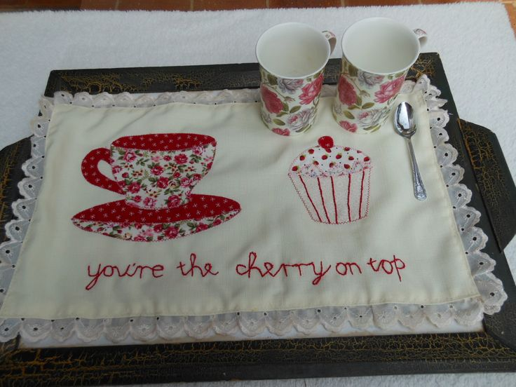 Tea Tray cloth with appliqued tea cup and cup cake.