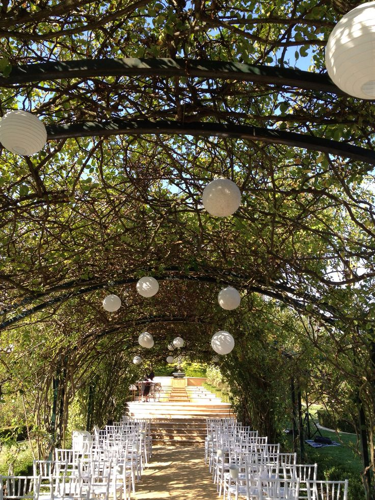 Tiffany chairs and lanterns line the aisle for a whimsical wedding ceremony. Photo: www.wedding-dayz.net.au Location: Morning Star Estate