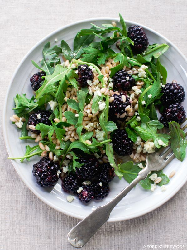 This light salad layers fresh berries with warm farro, bitter arugula and a bit of Gorgonzola all drizzled with a light blackberry-balsamic vinaigrette.