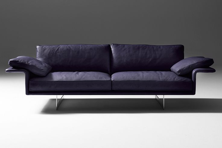 Modular sofa with structure in metal, with elastic belt spring system stretched over a metal frame. Padding in high-resilience expanded polyurethane, upholstery in thermo-bonded fibre with stretch jersey. Metal armrest padding in high-resilience expanded polyurethane. Seat cushions in 100% European, channelled goose feather, down, closed in independent rooms filling with central insert high-resilience polyurethane foam in different densities and memory foam. Back cushions in100% European…