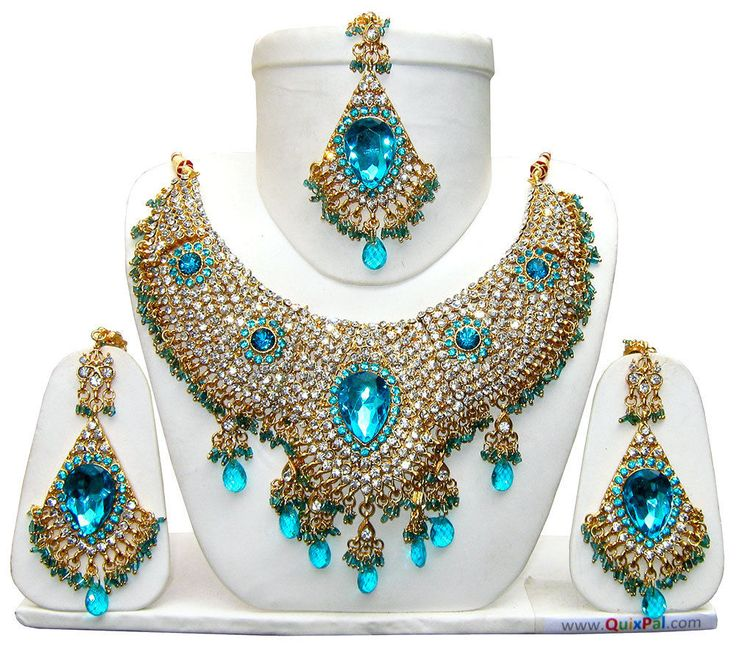 Creatively designed in lovely patterns in alloy metal with fine golden tone, the elaborate necklace and the elegant earrings andmangtikka (Forehead Jewellery) are embellished with vivid colors dazzling stones.   eBay!