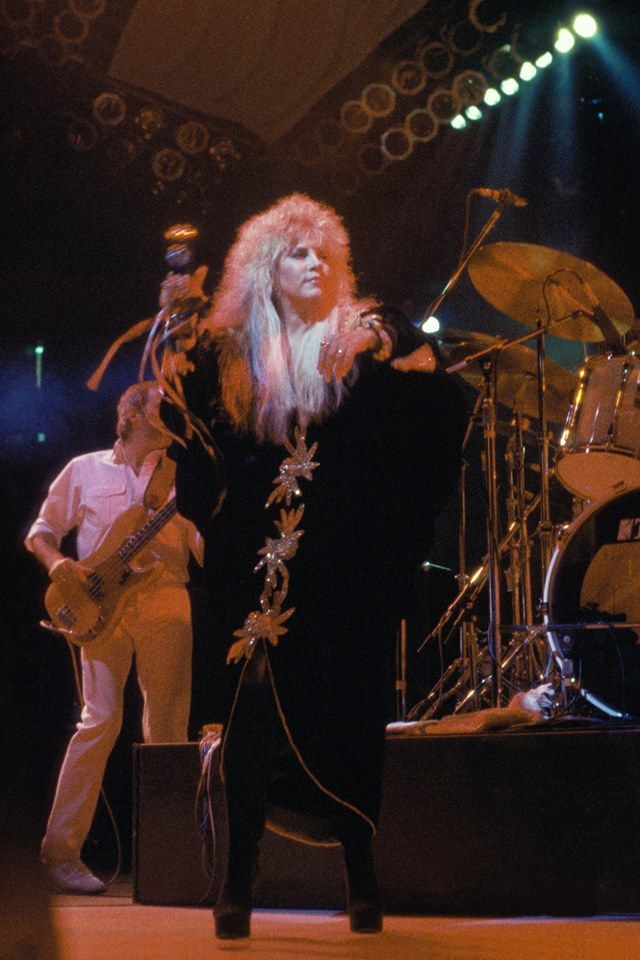 Stevie  ~  ☆♥❤♥☆ ~   with awesome BIG hair and a stunning outfit, with John McVie behind her, performing during the 'Tango In The Night' tour, Uniondale, NY