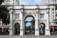 At the north-east corner of Hyde Park is the Marble Arch. It was originally built in 1827 as a gateway to Buckingham Palace, but it was moved to its present location in 1851. The design by John Nash was based on the Arch of Constantine in Rome.