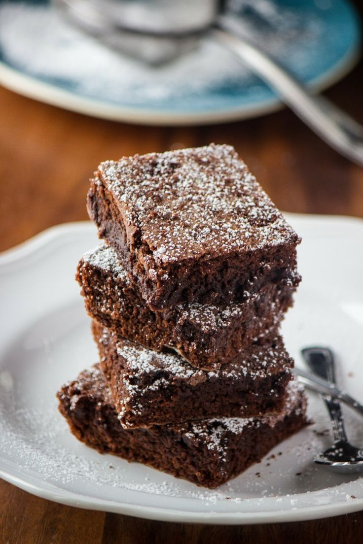Moist Brownies. Made with butter, sugar, eggs, cocoa, flour, vanilla, baking powder, and salt.