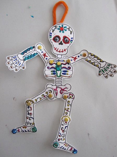 Add a little spooky fun into afternoon crafting with a sweet and simple slinky skeleton. Keep it classic and cool or add color and sparkle for some Dios De Los Muertos delights.