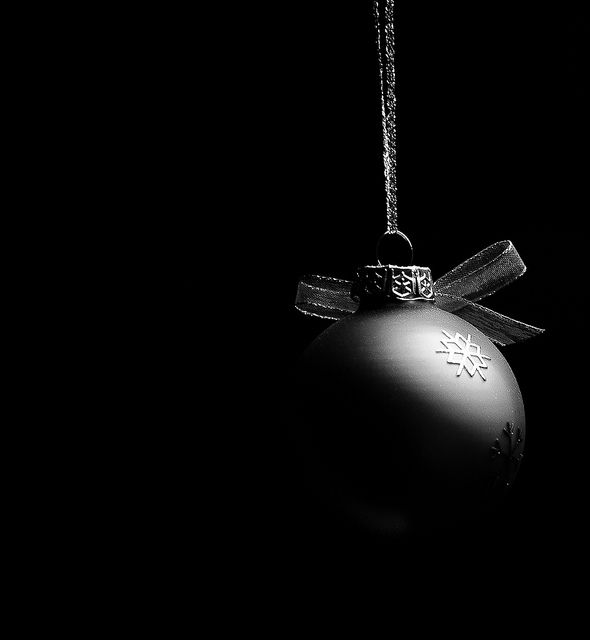 Low key photo of a hanging Christmas bauble