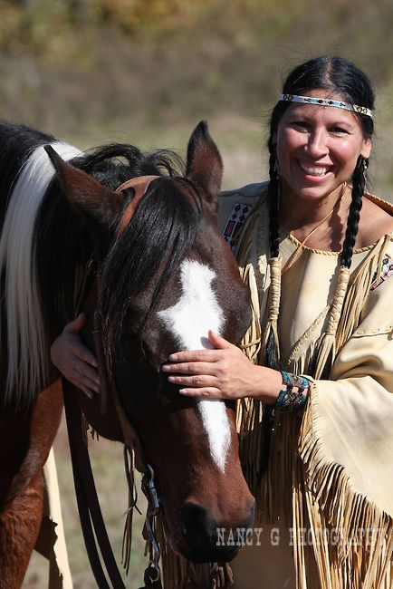 Horse whisperer A Native American Indian woman put her horse to sleep More