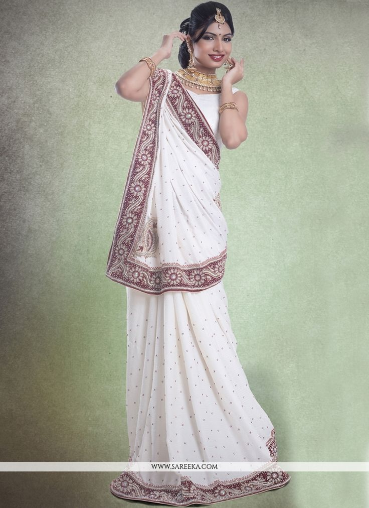 Make the heads flip the moment you dress up in this sort of a attractive off white jacquard classic designer saree. Beautified with embroidered and patch border work all synchronized well through the ...