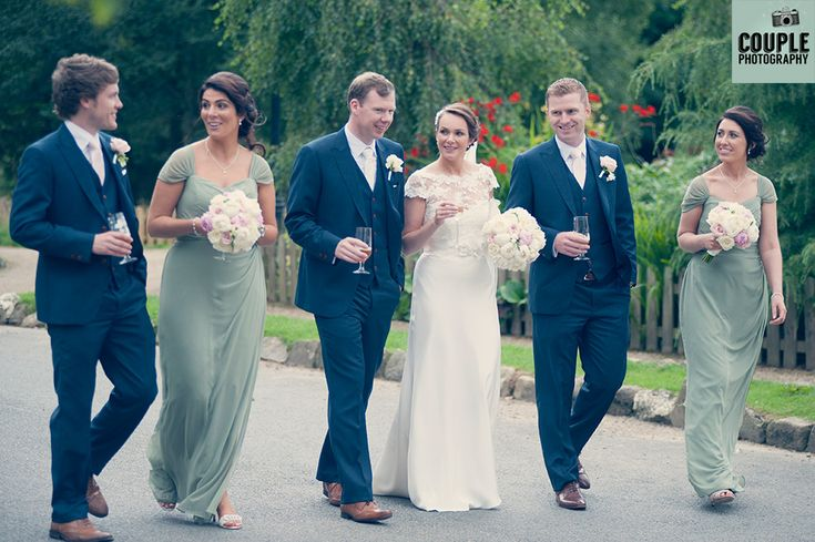 The bridal party goes for a stroll through the beautiful gardens. Wedding photography at The Brooklodge Hotel by Couple Photography.