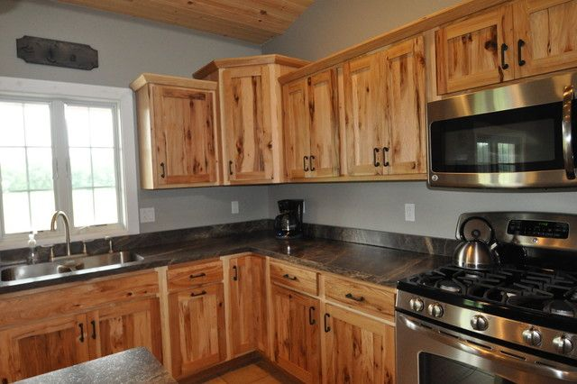 Rustic hickory maybe? The dark counters really help the cabinets pop!