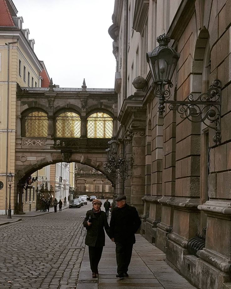 Two old couple on Rainy Sunday at Dresden #Germany #love #good #oldcouple #dresden #happymoments
