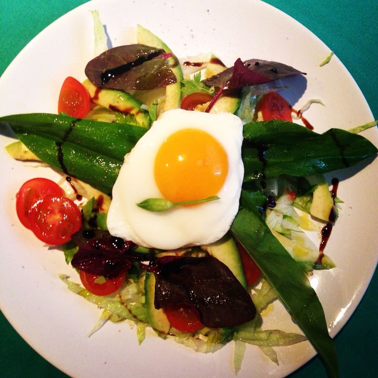 Breakfast with salad and poached eggs