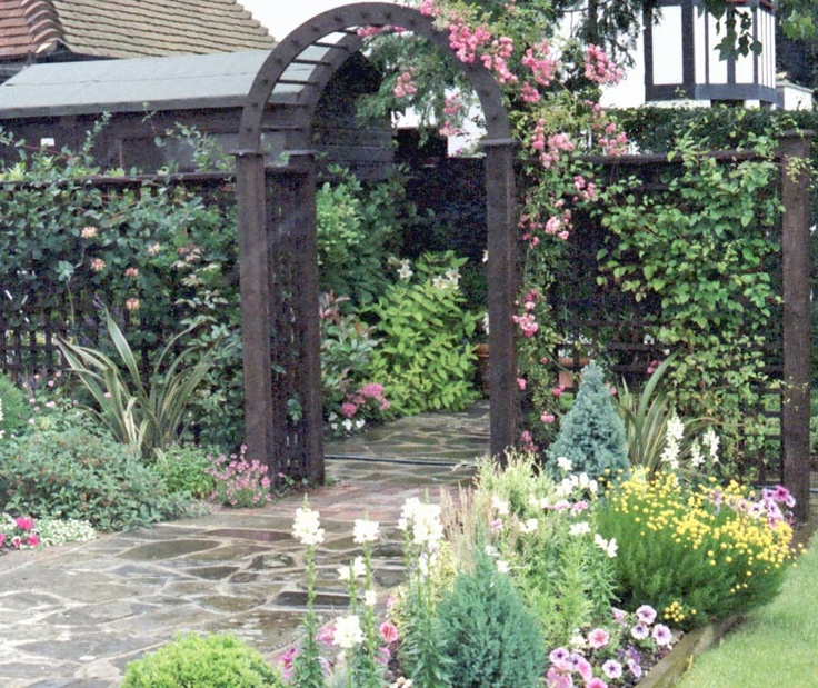 Timber Archway With Side Trelliage, Leading To A Flower Garden, The Paving    Not · Tower HousePerennial ...