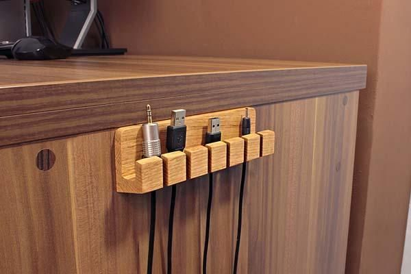 Need a handy and suitable way to manage your cables on your wood table? Take a look at the handmade wooden cable organizer, it may be a nice companion for your