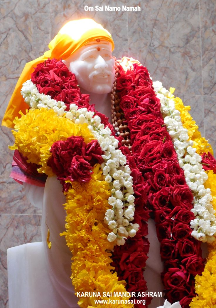 Statue of Shirdi Sai Baba in the Shrine .... picture taken at PRANA PRATIKSHA prayers, with natural halo formation by sunlight.
