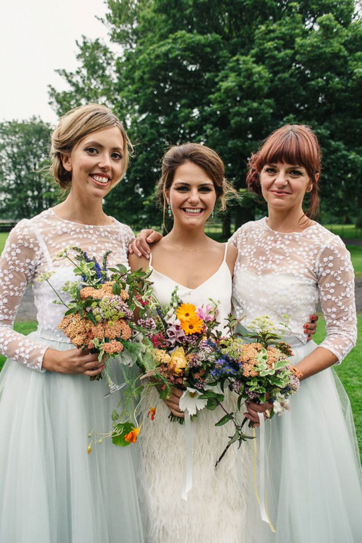 Bridesmaids wear tulle skirts with embroidered tops   Images by http://photosbyzoe.co.uk/