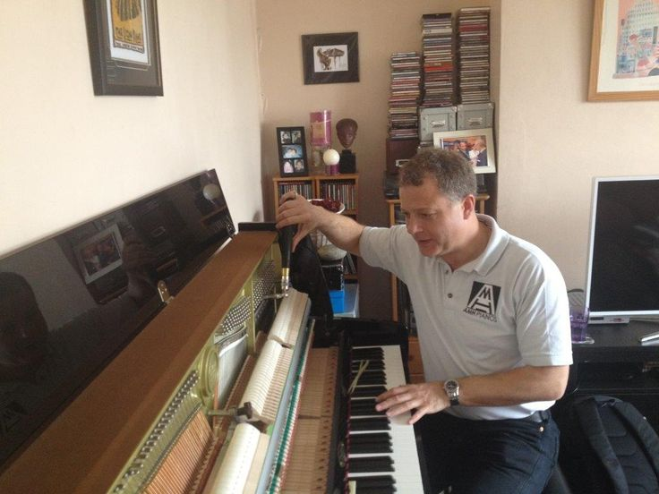 Andy Howard tuning a piano