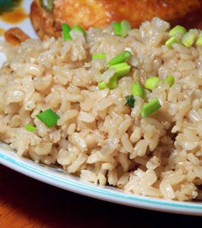 Garlicky Brown Rice - olive oil - brown rice - 6 garlic cloves - canned chicken broth - green onions