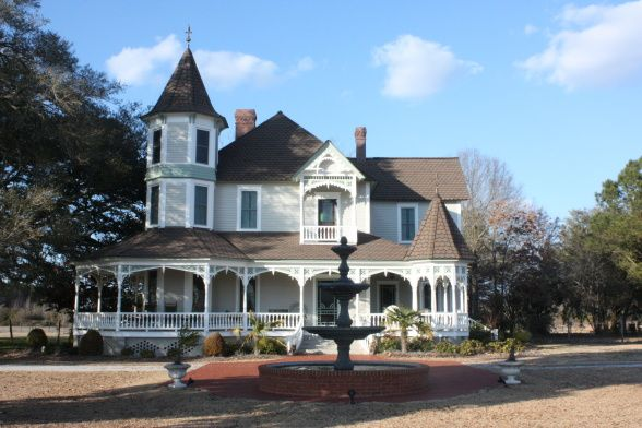Victorian farmhouse renovation, SC circa 1900 Victorian style farmhouse was completely renovated.  , After renovation.  Exterior paint was Benjamin Moore:  Revere Pewter for siding, Cottonball for trim, Garden path for accent.  The fountain was added a few months later. , Home Exterior Design