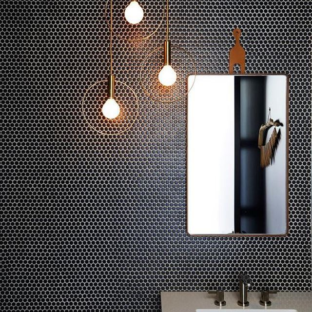 We Ve Never Met A Penny Tile Wall We Didn T Love And This All Black Statement By Jette C California Beach House Modern Bathroom Lighting Bathroom Renovations