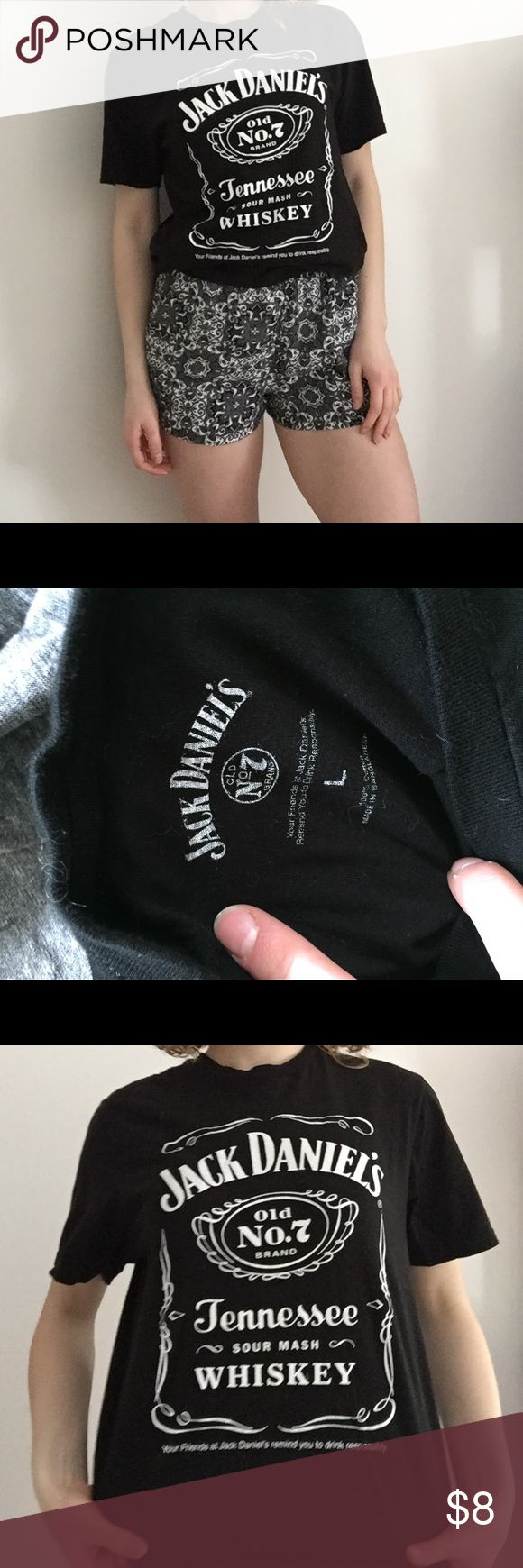 Jack daniels T-shirt Black jack Daniels T-shirt. I am pictured wearing a L but I received a large shipment of these from a bar promotion and have a variety of sizes left in men's. I only have mediums left in women's sized but they are all unworn and new (they didn't come with tags but in original packaging) jack daniels Tops Tees - Short Sleeve