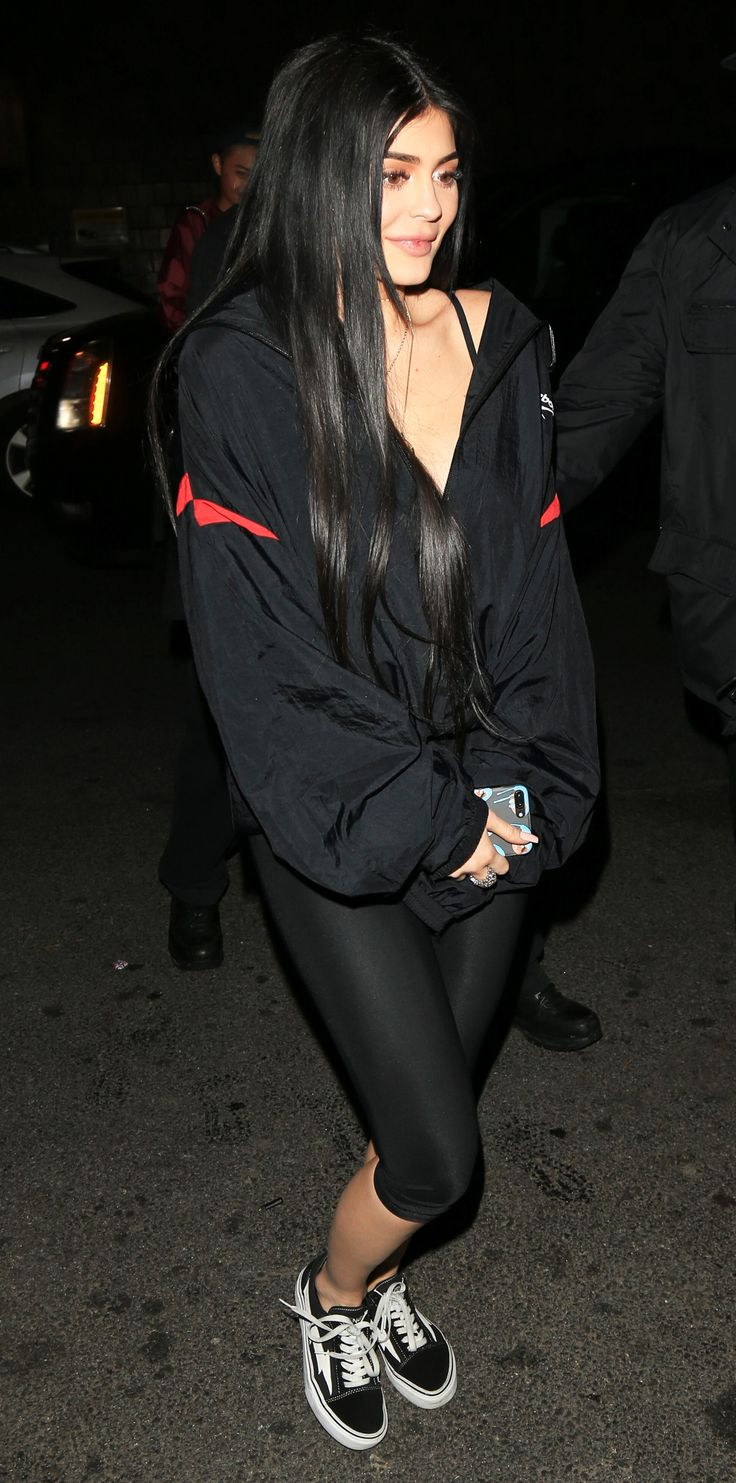 Kylie Jenner sported cropped black leggings with lace up heels and a black oversized jacket for the bash.